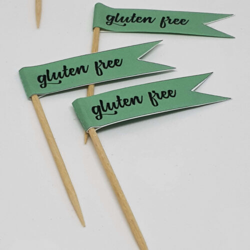 Pastel green GLUTEN FREE toothpick food flags close up image