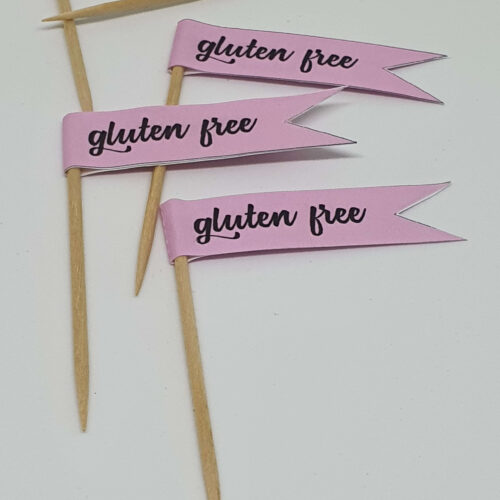 Pastel pink GLUTEN FREE toothpick food flags close up image